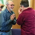 "Image of Namaste greeting between two men. The ""Namaste"" greeting we share during services reflects the spirit with which we work and play together -- honoring and recognizing the Divinity in each one."