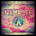 Interfaith Center artwork of hands folded in prayer, symbolizing the Sanskrit word namaste