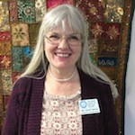 Head shot of Delyth Balmer, who serves as the Administrator and Associate Minister at the Interfaith Center for Spiritual Growth in Ann Arbor.
