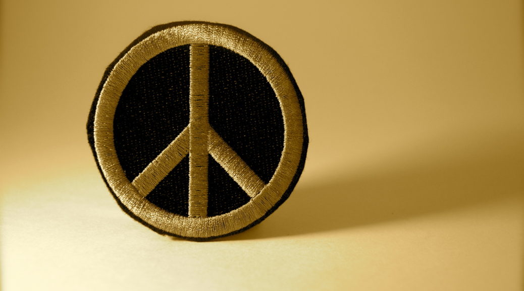 Peace patch on golden background.